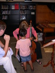 A young attendee shows interest in the viol.