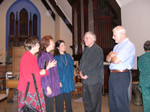 Mary Lou Paschal and Richard Kingston talk with ensemble members following a concert a St. Martin's Episcopal, Charlotte, 2003