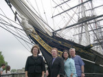 Windblown in front of the last clipper ship, The Cutty Sark, built in Scotland in the 19th century, now in Greenwich.