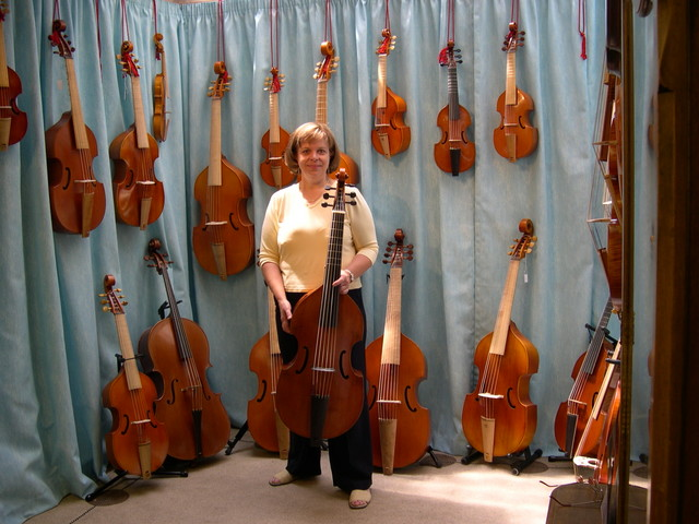 Holly with her viol and all the other viols - London Harpsichord Centre