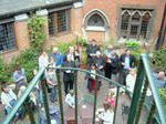 Vicar Philip, of St. Matthew Church, left of center, thanks us for our music as the congregation gathers in the courtyard for refreshments.